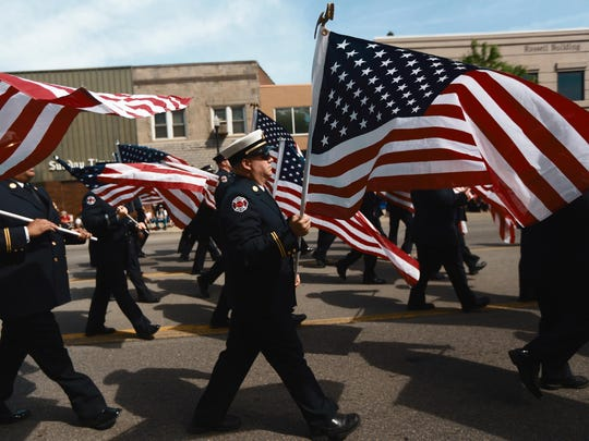 The Dearborn Fire Department Color Honor Guard marches in the 90th Memorial Day parade in Dearborn, Mich. on Monday, May 26, 2014. Kimberly P. Mitchell/Detroit Free Press