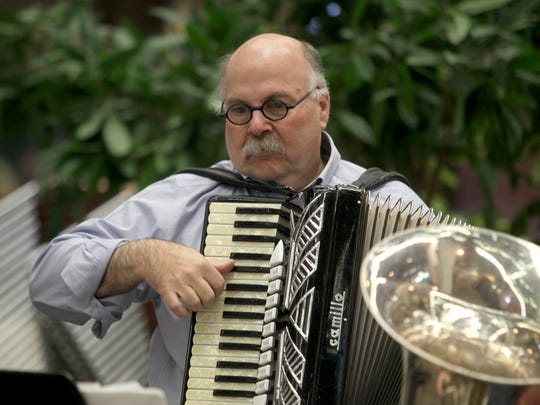 The Java Jews Klezmer Band's Abe Goldstien performs during a Hanukkah celebration in 2010 at the University of Iowa Hospitals and Clinics in Iowa City.
