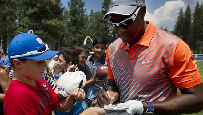 NFL Hall of Fame wide receiver Jerry Rice signs autographs and takes photos with fans at the American Century Championship on Thursday at Edgewood Tahoe Golf Course in Stateline.