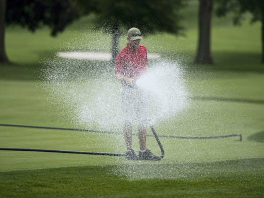 A grounds crew member at the Lancaster Country Club waters a green as they prepare the course for the 2015 U.S. Women's Open which will be held at the club July 9-12, 2015. Jeremy Long -- Lebanon Daily News