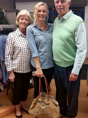 Ladies night out A special event benefiting Reitz Memorial High School PTO took place at Gehlhausen Floral with a Ladies Night Out' fundraiser. Guests enjoyed shopping, a style show, door prizes and raffles, light appetizers and beverages. Mike Blake joined his wife Jenny and daughter in law Casey for a family photo. Proceeds will be used to fund projects for RMHS students, teachers and staff.