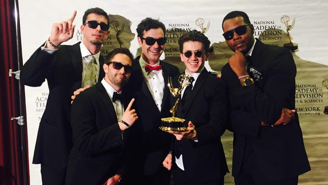 The film crew of Elite Daily with their Emmy Award. Weston Green is in the center.