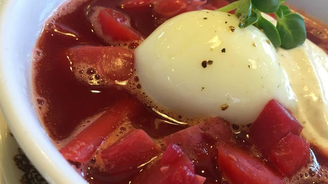 Indiana home cooking inspires Milktooth's eclectic breakfast/brunch fare. A soft-poached egg and caraway creme top borscht vegetable soup.