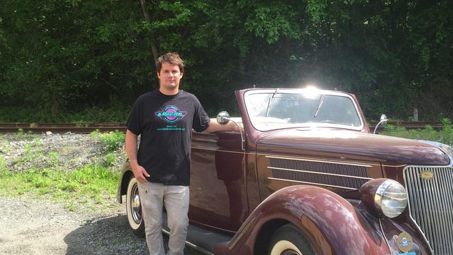 Kade Madsen, owner of Madsen Classic Auto Restorations in Dover, with a 1936 Cabriolet.