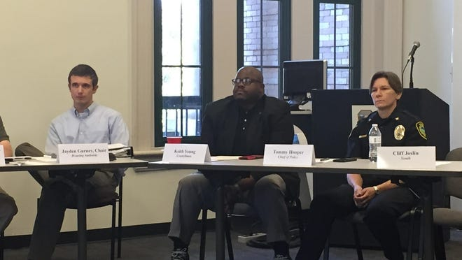 Asheville City Councilman Keith Young and now-former Police Chief Tammy Hooper attend a 2016 meeting of Citizens Police Advisory Committee  following outcry over a police use-of-force incident involving a 16-year-old girl who was thrown to the ground by an officer.
