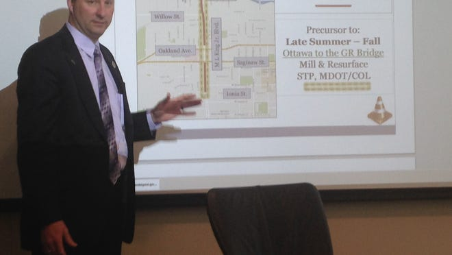Chad Gamble, director of Lansing's Public Service Department, explains Thursday at City Hall the lead abatement and resurfacing projects planned for Martin Luther King Boulevard.