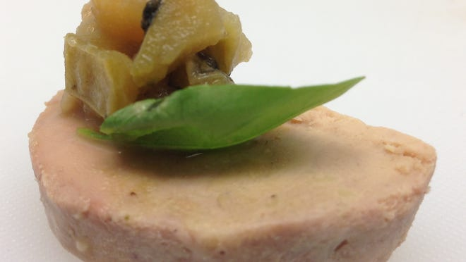 Torchon of Duck Foie Gras with Granny Smith Apple and Fennel Chutney.