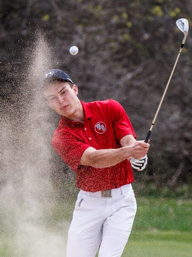 Waukesha South golfer Colin Kammerzelt hits out of the sand during Round 1 of the Waukesha County Boys High School 36-hole Championship at Naga-Waukee Golf Course on Friday, April 22, 2016.