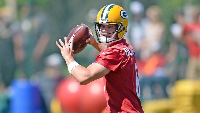 Green By Packers quarterback Matt Blanchard throws to a receiver during minicamp.