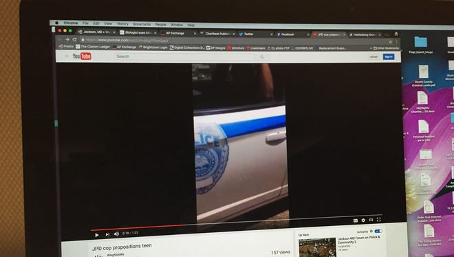 This is a photo of video posted to YouTube that allegedly shows a Jackson police officer propositioning a young woman from his patrol car.