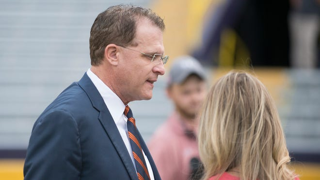 Auburn head coach Gus Malzahn talks to CBS reporter before the NCAA football game between Auburn and LSU on Saturday, Oct. 14, 2017, at Tiger Stadium in Baton Rouge, La.