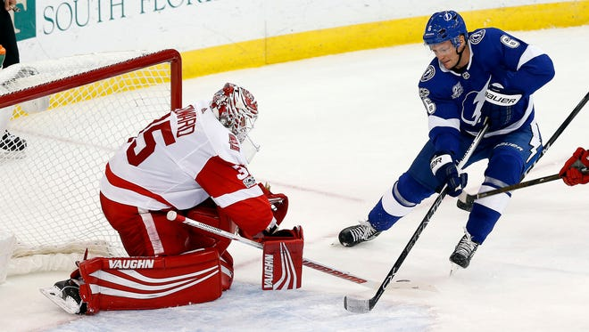 Lightning defenseman Anton Stralman shoots on goal as Red Wings goalie Jimmy Howard makes a save during the second period of the Wings' 3-2 loss on Thursday in Tampa, Fla.