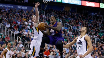 Dec 6, 2016: Phoenix Suns guard Eric Bledsoe (2) looks to pass against Utah Jazz forward Gordon Hayward (20) and center Rudy Gobert (27) in the second quarter at Vivint Smart Home Arena.