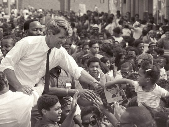 Sen. Robert Kennedy clasps the hand of an unidentified