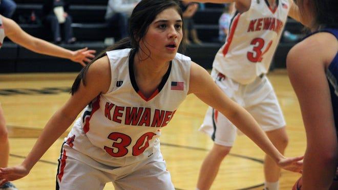 Adriana Contreras (30) plays defense against a Newman Central Catholic ballhandler on Thursday at Brockman Gymnasium.
