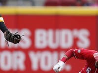 Reds starting pitcher Raisel Iglesias warms his throwing hand between pitches in the top of the fourth inning.