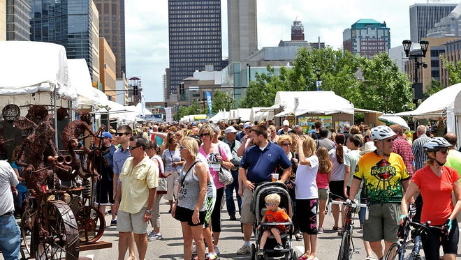 View looking east on Grand Ave. as folks enjoyed the artist's booths at the Des Moines Arts Festival on Saturday June 28, 2014.