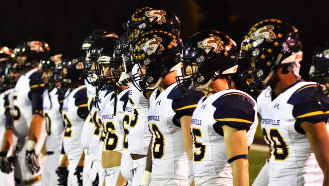 Stephenville players wait for the coin toss before their 28-21 win over Brownwood in the Big Country Game of the Week.