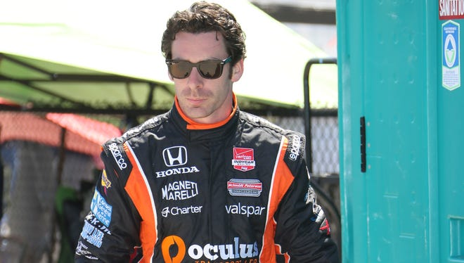 Simon Pagenaud walks to the pit area for a practice session for the IndyCar's Detroit Grand Prix on Belle Isle.