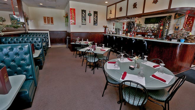 The dining room and bar at Shanghai Chinese Restaurant in Waukee.