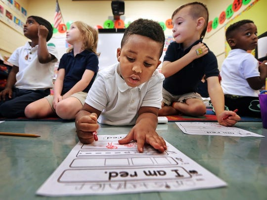 Grahamwood Elementary kindergarten student Christopher Beaumont (center) works on a colors assignment in Myra Jenkins' class. Students at Grahamwood Elementary and other Shelby County Schools return to school Aug. 12. File photo