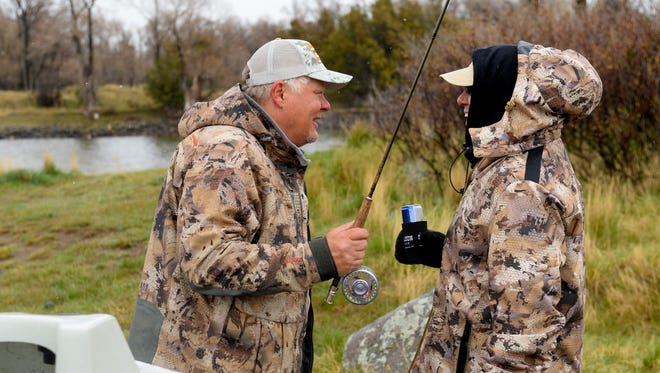 Steve Potter, left, and Joe Jedlicka chat before launching their boats on the Yellowstone River for a day of fly fishing in April.