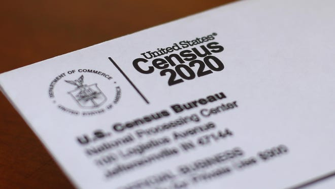 This Sunday, April 5, 2020, photo shows an envelope containing a 2020 census letter mailed to a U.S. resident in Detroit.