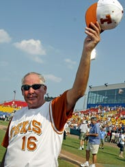FILE - In this June 26, 2005, file photo,  Texas coach Augie Garrido tips his hat to the crowd after winning the 2005 Baseball College World Series in Omaha, Neb. Garrido, who won three national baseball championships at Cal State Fullerton and two more at Texas, has died, the University of Texas announced Thursday, March 15, 2018. He was 79. (AP Photo/Eric Francis, File)