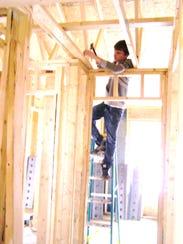 Volunteer Steven Bierbower works on a Habitat home.