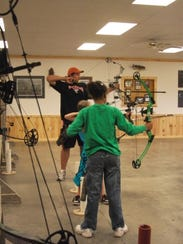 Leaders help to guide young 4-H members during a shooting