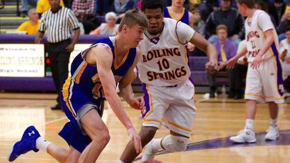 Waynesboro's Evan Hine, left, works around a Boiling Springs defender last week. The Indians beat the Bubblers and have won three of their last four.