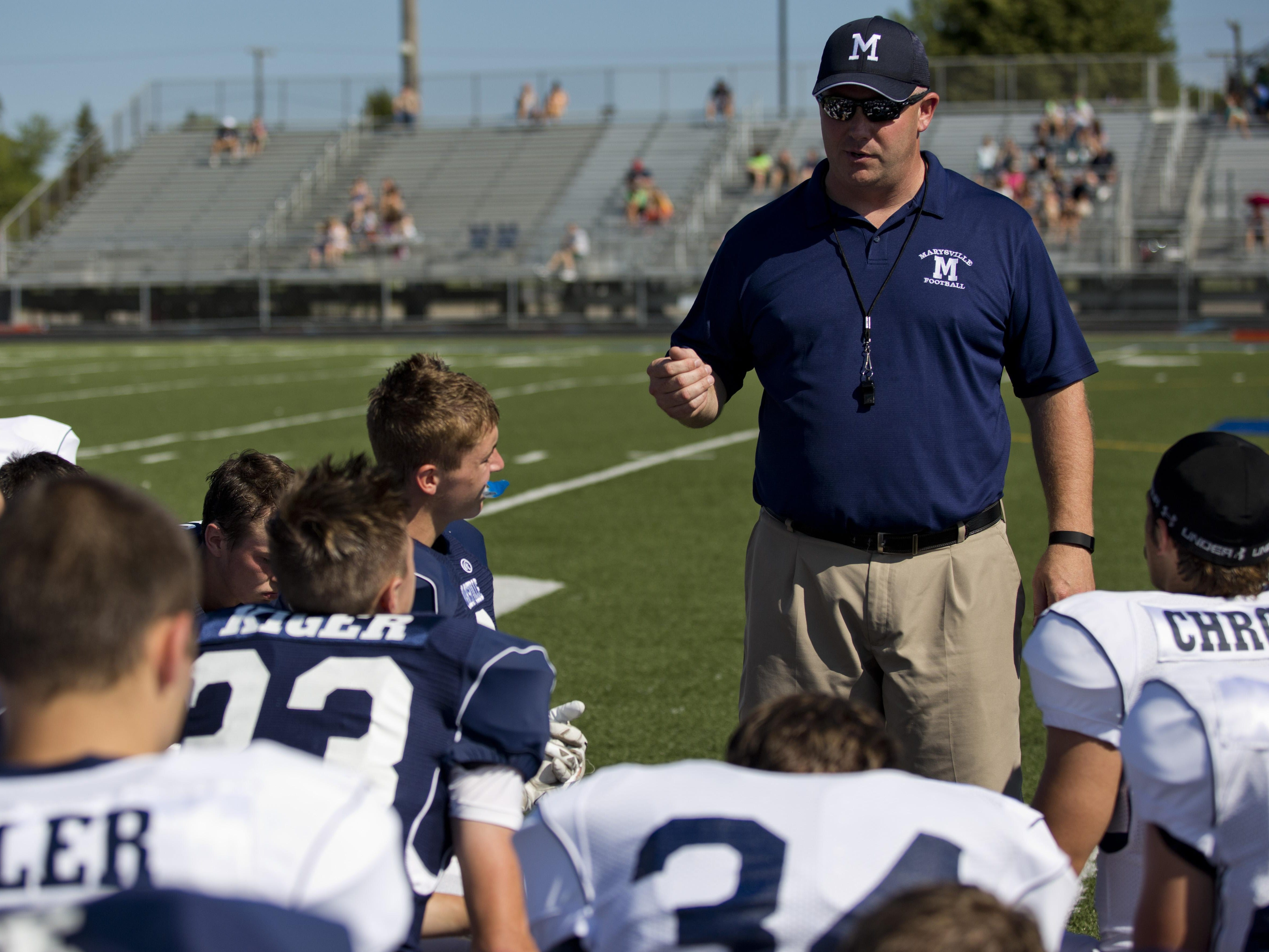 Coach Mark Caza is preaching against overconfidence as his Vikings enter the season in the competitive Macomb Area Conference Gold Division.