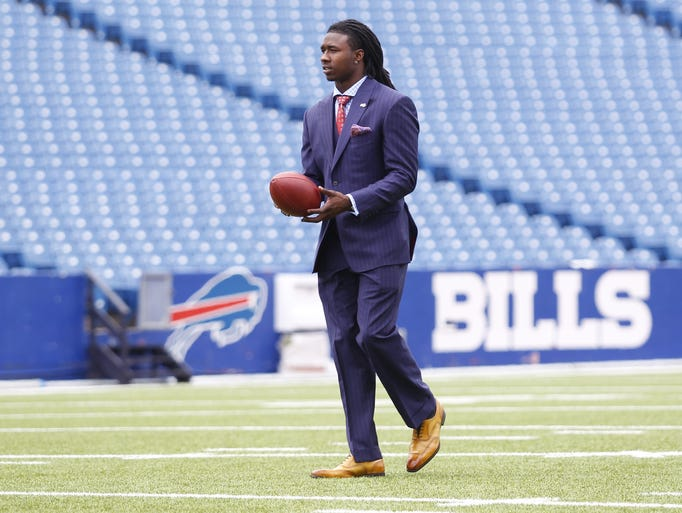 Buffalo Bills first round draft pick Sammy Watkins walks across the field during a photo opportunity at Ralph Wilson Stadium in Orchard Park, N.Y., Friday, May 9, 2014. (AP Photo/Bill Wippert)