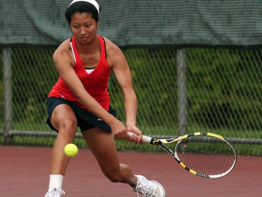 Mountain Lakes second singles Kim Yi returns a backhand