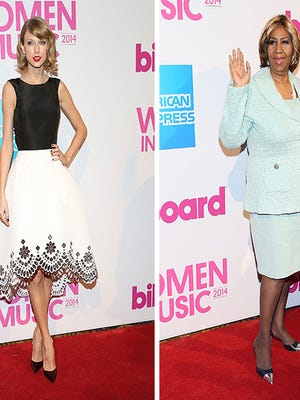 Singers Taylor Swift and Aretha Franklin attend the 2014 Billboard Women In Music Luncheon on Dec. 12, 2014.