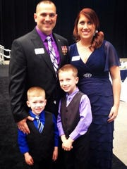Marine veteran Sam Deeds with his wife April and sons