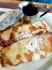 Galaxy Diner's strawberry cream cheese crepes were made to order and stuffed with cream cheese and fresh strawberries and served with a mini pitcher of warm maple syrup.