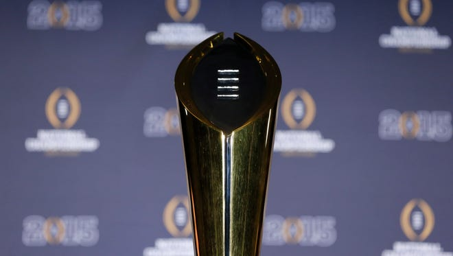 Genral view of the College Football Playoff trophy during a press conference at Renaissance Dallas Hotel.
