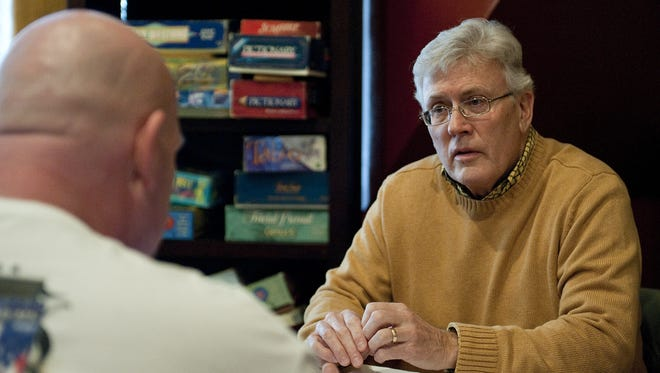 In this Post-Crescent Media file photo, Stephen Otto of Appleton, Wisconsin meets with a  released incarcerated man as part of Community Circles of Support, a program that helps formerly incarcerated people transition back into society.