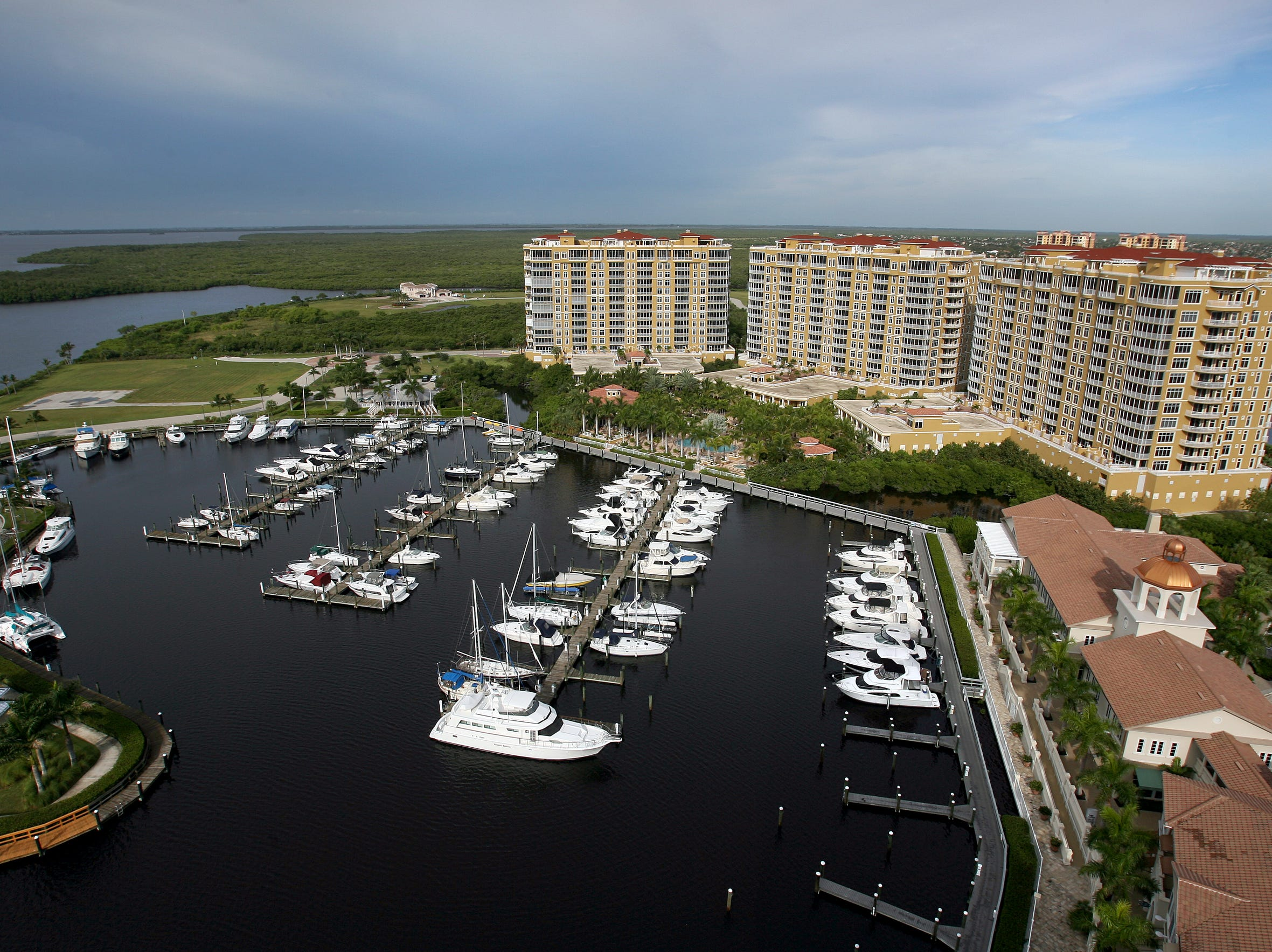 A penthouse view from The Resort at Marina Village luxury hotel of the Tarpon Point Marina basin, shops and Tarpon Landings, a trio of high-rise condominiums that recovered after the overall development became part of one of the biggest foreclosures in Southwest Florida history.