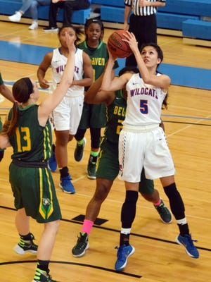 Louisiana College's Kourtney Kling (4, right) shoots over Belhaven's Candler Gregory (13, left) Saturday.