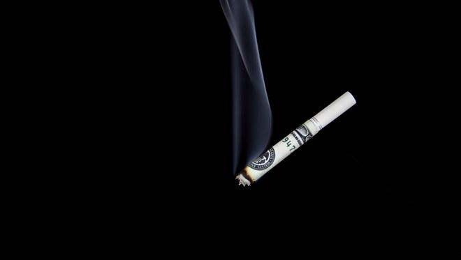 The cost of smoking: A pack-a-day smoker in Tennessee will spend about $93,000 in a lifetime on cigarettes.