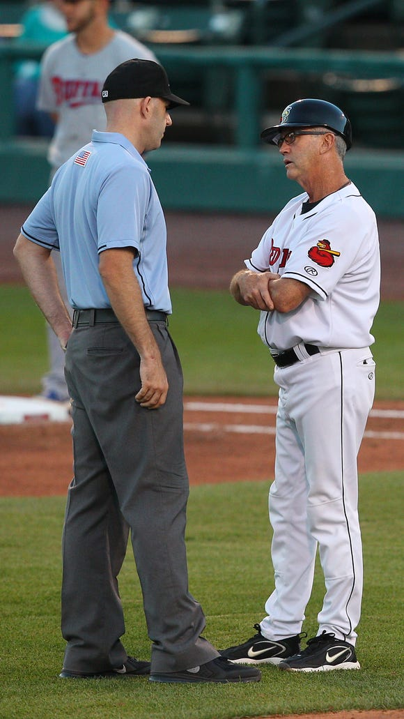 Red Wings manager Gene Glynn has a few extra words for home plate umpire Ben May and his strike zone.
