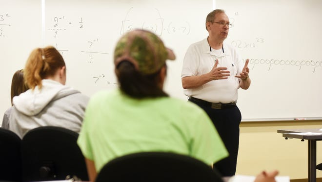Richard Jones teaches a math class at COTC in Coshocton recently.