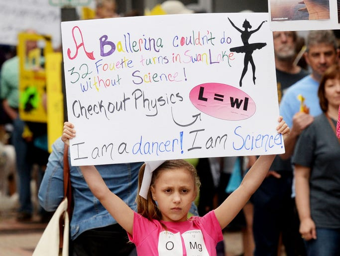 Adeline Horan holds up a sign during the March for