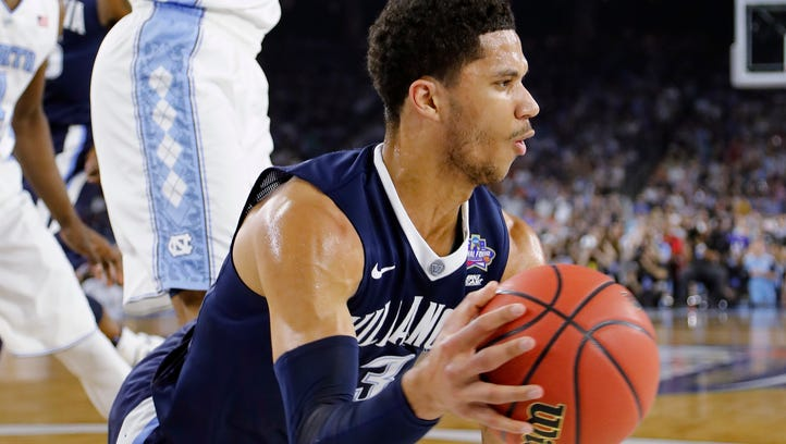 Villanova guard Josh Hart (3) passes the ball as North Carolina forward Isaiah Hicks (4) looks on during the first half of the NCAA Final Four tournament college basketball championship game Monday, April 4, 2016, in Houston.