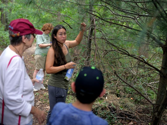Elizabeth Kligge (right) leads a nature walk about foraging food at Old Pine Farm Natural Lands Trust in the Blackwood Terrace section of Deptford Township.