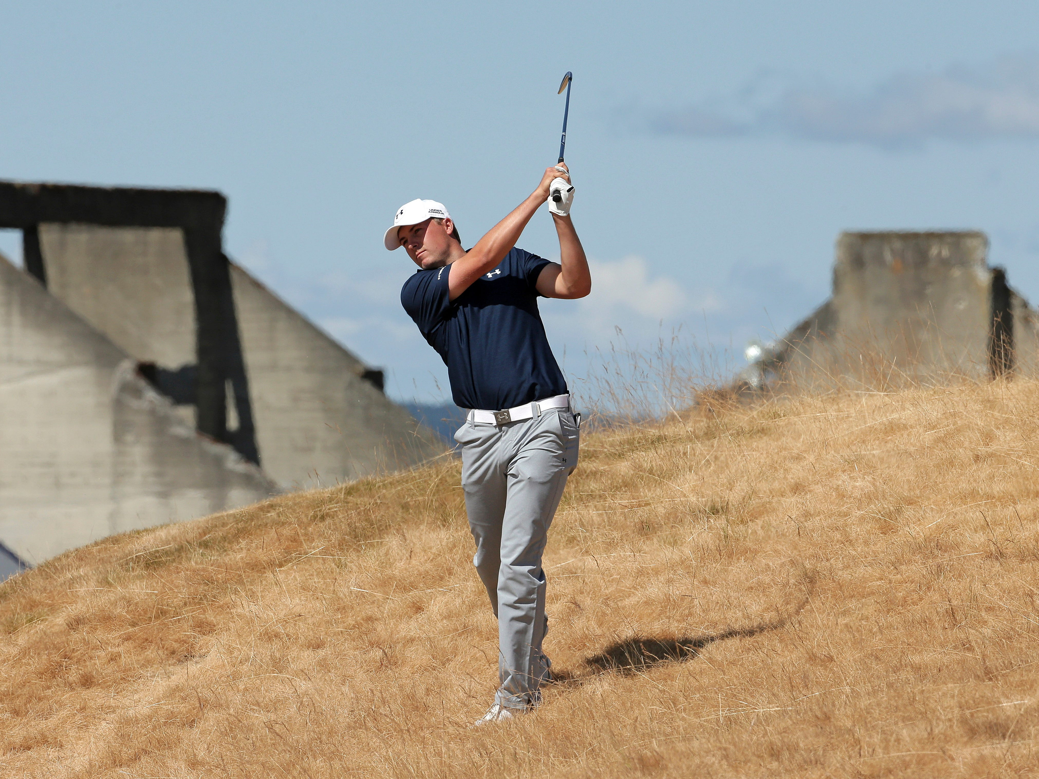 Jordan Spieth hits out of the tall fescue grass on the 18th hole during the second round of the U.S. Open golf tournament at Chambers Bay on Friday, June 19, 2015 in University Place, Wash. (AP Photo/Charlie Riedel)