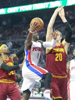Pistons guard Reggie Jackson drives against the Cavaliers' Timofey Mozgov during the first quarter Tuesday at the Palace.