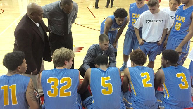 Cape Henlopen coach Stephen Re motivates his team between the first and second quarters. The Vikings rallied for a 47-46 victory at Smyrna on Friday night.